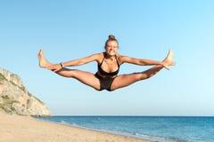 Girl jumping in the beach Stock Photos