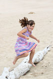 Girl jumping on beach Stock Photo