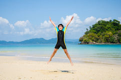 Girl jumping on the beach. Stock Photography
