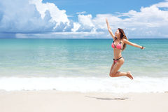Girl jumping on a beach Royalty Free Stock Photo