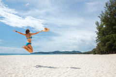 Girl jumping on a beach Stock Photo