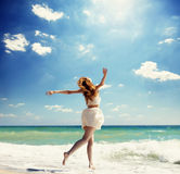 Girl jumping at the beach. Royalty Free Stock Photography