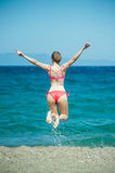 Girl Jumping at Beach Royalty Free Stock Photos