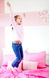 Girl jumping on the bed Royalty Free Stock Image