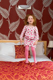 Girl (5) jumping on bed Royalty Free Stock Photos