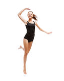 Girl jumping in black cotton underwear. Sport and health care concept - beautiful girl jumping in black cotton underwear Royalty Free Stock Photo