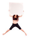 Girl jumping with blank board Royalty Free Stock Image