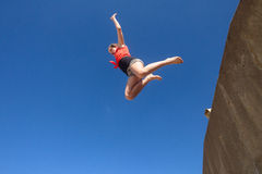 Girl Jumping Blue Parkour Royalty Free Stock Photography