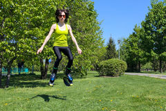 Girl in jumping boots outdoors fitness Royalty Free Stock Image