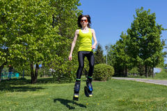 Girl in jumping boots outdoors fitness Stock Photos