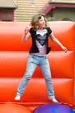 Girl jumping on a bouncy castle Royalty Free Stock Photos