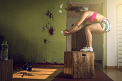 Girl jumping on box in gym Royalty Free Stock Photo