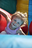 Girl on Jumping castle. Young girl child playing on Jumping caslte Royalty Free Stock Images