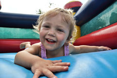 Girl on Jumping castle. Young girl child playing on Jumping caslte Royalty Free Stock Photos