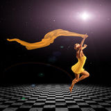 Girl jumping on checkered floor Royalty Free Stock Photo