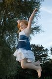 Girl jumping and cheering royalty free stock photos