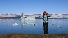 Girl jumping on the coast of the glacial lake Jokulsarlon stock footage
