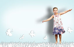 Girl jumping in a color dress Stock Photo