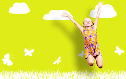 Girl jumping in a color dress Stock Photography