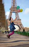 Girl jumping with colourful balloons Royalty Free Stock Images