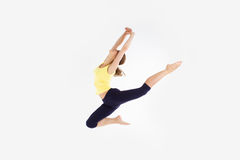 Girl jumping dancing isolated on a white studio Royalty Free Stock Photography