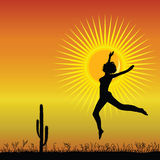 Girl jumping in the desert black silhouette Royalty Free Stock Photography