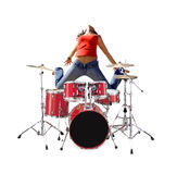 Girl jumping with Drum kit. Girl jumping behind a red Drum kit isolated over white Stock Photography