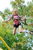 Girl jumping on elastic bands Royalty Free Stock Photo
