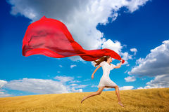 Girl jumping with fabric Royalty Free Stock Photo