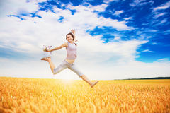 Girl is jumping in field Royalty Free Stock Image