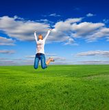 Girl jumping in a field Stock Photo