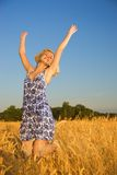 Girl jumping in the field Stock Images