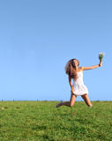 Girl jumping on field Royalty Free Stock Images
