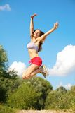 Girl jumping in forest Royalty Free Stock Image