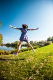 Girl jumping on the grass stock images
