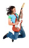 Girl jumping with a guitar Royalty Free Stock Images