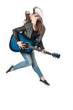 Girl jumping with a guitar Royalty Free Stock Photography