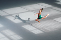 Girl jumping gymnast trains in sports school Royalty Free Stock Photos