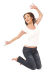 Girl jumping happy with her arms raised on a white Royalty Free Stock Photography