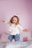 Girl Jumping on her bed Royalty Free Stock Image