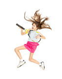 Girl jumping high and playing on tennis racket as on guitar Stock Images