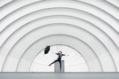 Girl Jumping While Holding Umbrella Royalty Free Stock Photography