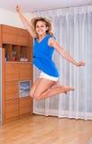 Girl jumping at home Royalty Free Stock Image