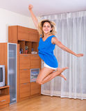 Girl jumping at home Royalty Free Stock Images
