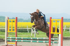 Girl jumping with horse Royalty Free Stock Photos