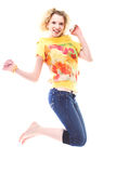 Girl jumping of joy royalty free stock photography