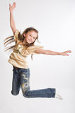 Girl jumping of joy Stock Image