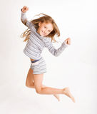 Girl jumping of joy Royalty Free Stock Images