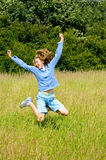 Girl jumping for joy. Outdoor portrait of girl jumping in the air Royalty Free Stock Image