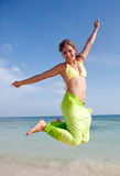 Girl jumping of joy Royalty Free Stock Photos